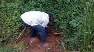 The Water Project:  Mzee Washes Hands At Spring