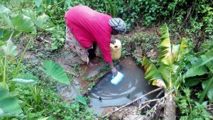 The Water Project:  Fetching Water At This Unprotected Water Source