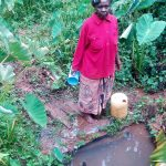 The Water Project: Koitabut Community, Henry Kichwen Spring -  Mrs Fith Kichwen At The Spring