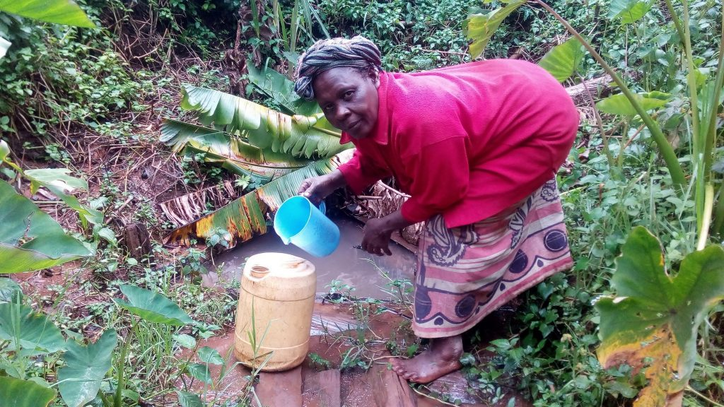 The Water Project : kenya18160-pouring-water-into-jerrycan