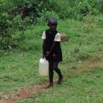 The Water Project: Chepnonochi Community, Chepnonochi Spring -  Child Carrying Water Container