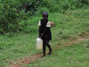 The Water Project:  Child Carrying Water Container