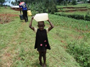 The Water Project:  Child Carrying Water On Her Head