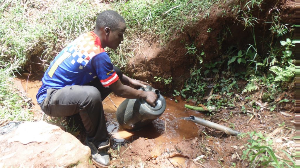 The Water Project : kenya18161-collecting-water-from-spring