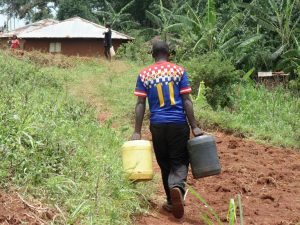The Water Project:  Duncun Carrying Water To His Home
