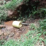 The Water Project: Chepnonochi Community -  Jerrycan Fills With Spring Water