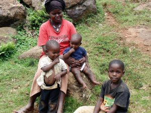 The Water Project:  Mary Amboka With Her Kids Use Water From Chepnonochi Spring