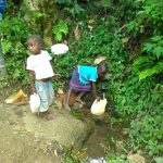 The Water Project: Shitoto Community -  Children Fetching Water At The Spring