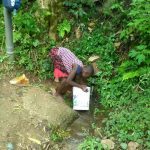 The Water Project: Shitoto Community -  Collecting Water From The Spring