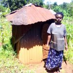 The Water Project: Upper Visiru Community, Wambosani Spring -  Mrs Obanda Beside Her Latrine