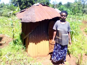 The Water Project:  Mrs Obanda Beside Her Latrine