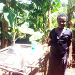 The Water Project: Upper Visiru Community, Wambosani Spring -  Woman And Dish Drying Rack