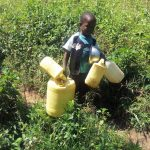 The Water Project: Masera Community, Murumba Spring -  A Child In The Community Heads To The Spring