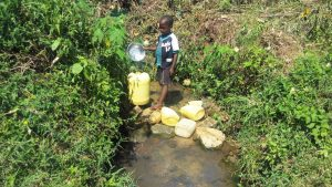 The Water Project:  Child Fills Large Jerrycan