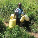 The Water Project: Masera Community, Murumba Spring -  Childs Hands Filled With Jerrycans