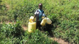 The Water Project:  Childs Hands Filled With Jerrycans