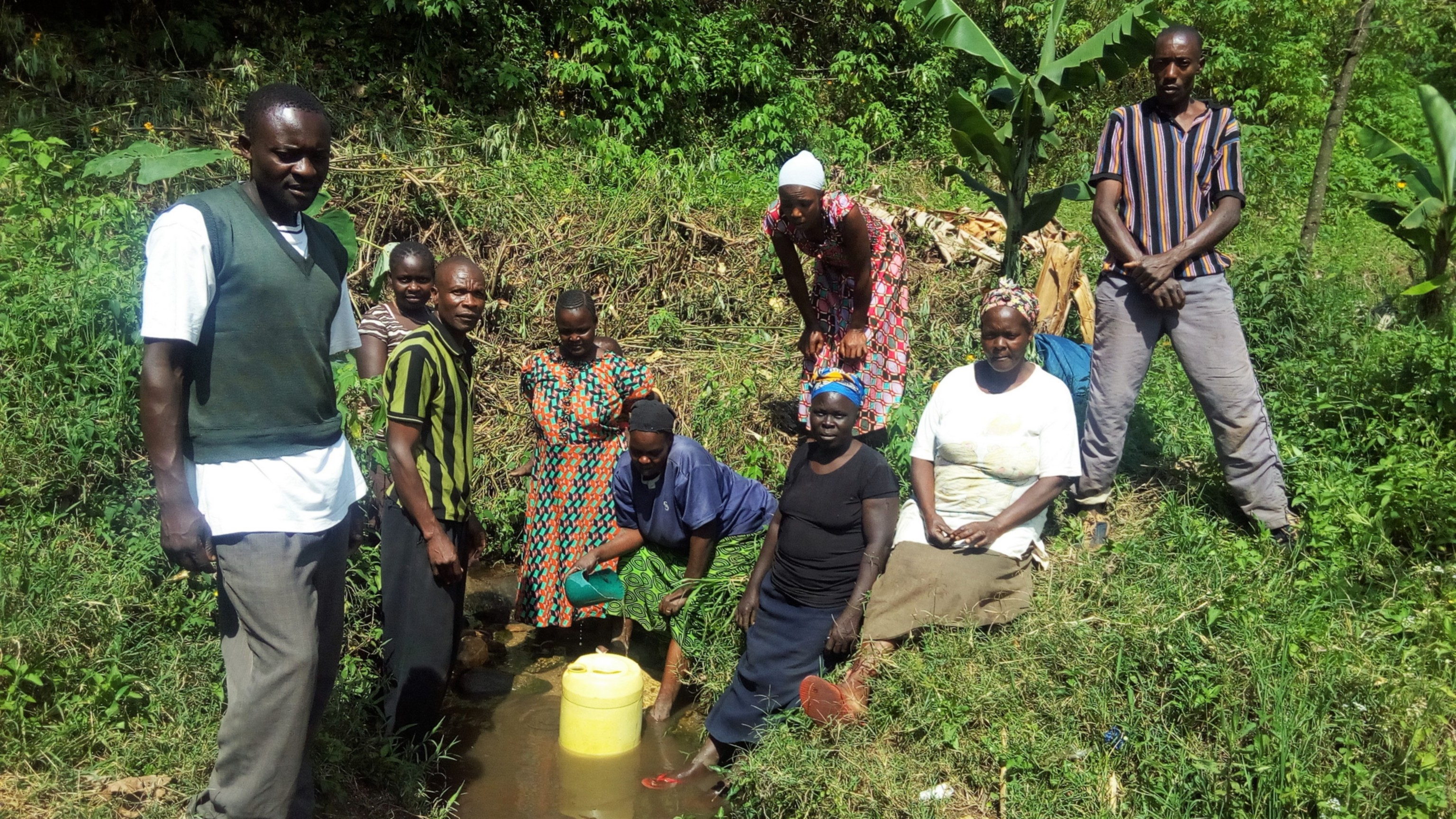 The Water Project : kenya18166-community-members-gathered-around-water-source