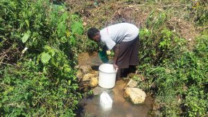 The Water Project:  Fetching Water By Scooping
