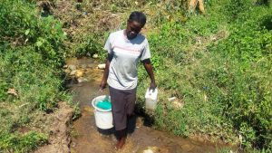 The Water Project:  Woman Carries Recently Fetched Water From Spring