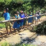 The Water Project: Masera Community, Murumba Spring -  Young People Stand On Bridge Above Stream