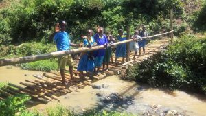 The Water Project:  Young People Stand On Bridge Above Stream