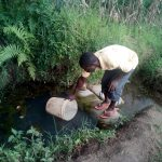 The Water Project: Elutali Community -  Vincent Drawing Water At The Spring