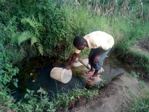 The Water Project:  Vincent Drawing Water At The Spring