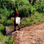 The Water Project: Irumbi Community A -  Returning Home With Buckets Filled With Water