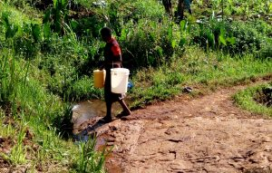 The Water Project:  Returning Home With Buckets Filled With Water