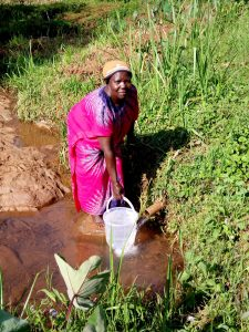 The Water Project:  Woman Fetches Water At Shatsala Spring