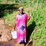 The Water Project: Irumbi Community A -  Woman Poses At Shatsala Spring