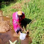 The Water Project: Irumbi Community A -  Fetching Water At Shatsala