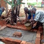The Water Project: Lwenya Community, Warosi Spring -  Sanitation Platform Construction