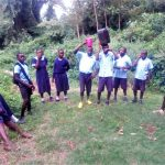 The Water Project: Shiru Primary School -  Waiting For Peers To Find Enough Water