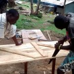 The Water Project: Lihanda Secondary School -  Working On The Latrine Door