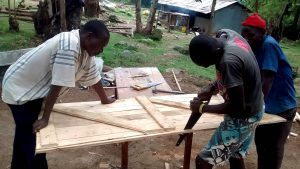 The Water Project:  Working On The Latrine Door