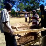 The Water Project: Chebunaywa Primary School -  Sifting Sand For Construction