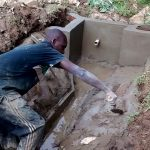 The Water Project: Lwenya Community -  Spring Protection Construction
