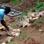 The Water Project: Elukani Community -  Man Bringing Stones To The Site