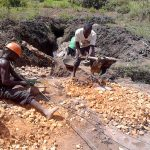 The Water Project: Musango Community, Dawi Spring -  Breaking Stones