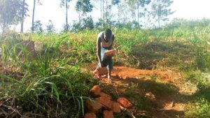 The Water Project:  Carrying Bricks To The Site