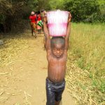 The Water Project: Kolia Community -  Helping Get Water For Drilling