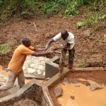 The Water Project: Elukani Community -  Filling In The Spring Box