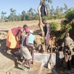 The Water Project: Musango Community, Ham Mwenje Spring -  Filling The Spring Box