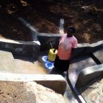 The Water Project: Mwichina Community -  Jacklne Okunyanyi Fetching Clean Water