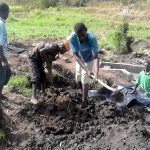 The Water Project: Musango Community, Dawi Spring -  Filling The Spring Box