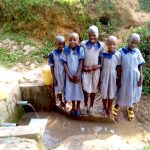 The Water Project: Imuliru Primary School -  Girls Showing Us Where They Get Water