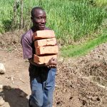 The Water Project: Ataku Community, Ataku Spring -  Carrying Bricks To The Spring