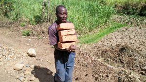 The Water Project:  Carrying Bricks To The Spring