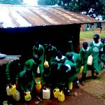 The Water Project: Erusui Girls Primary School -  Girls Getting Their Water Containers
